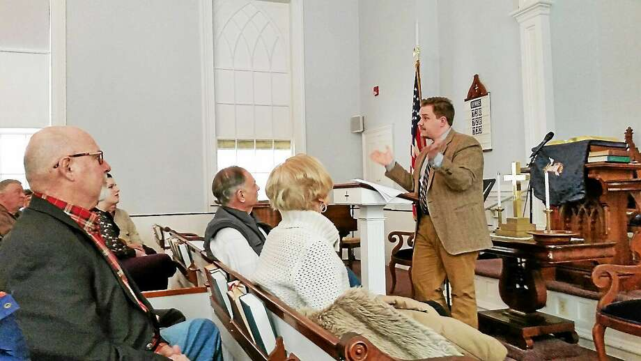 Actor and historian Luke G. Boyd discusses the mystery of The Colt Armory Fire of 1864 with a group of 30 people in attendance on Saturday afternoon at First Congregational Church at 865 Riverside Ave., Torrington. Photo: N.F. Ambery — Special To The Register Citizen