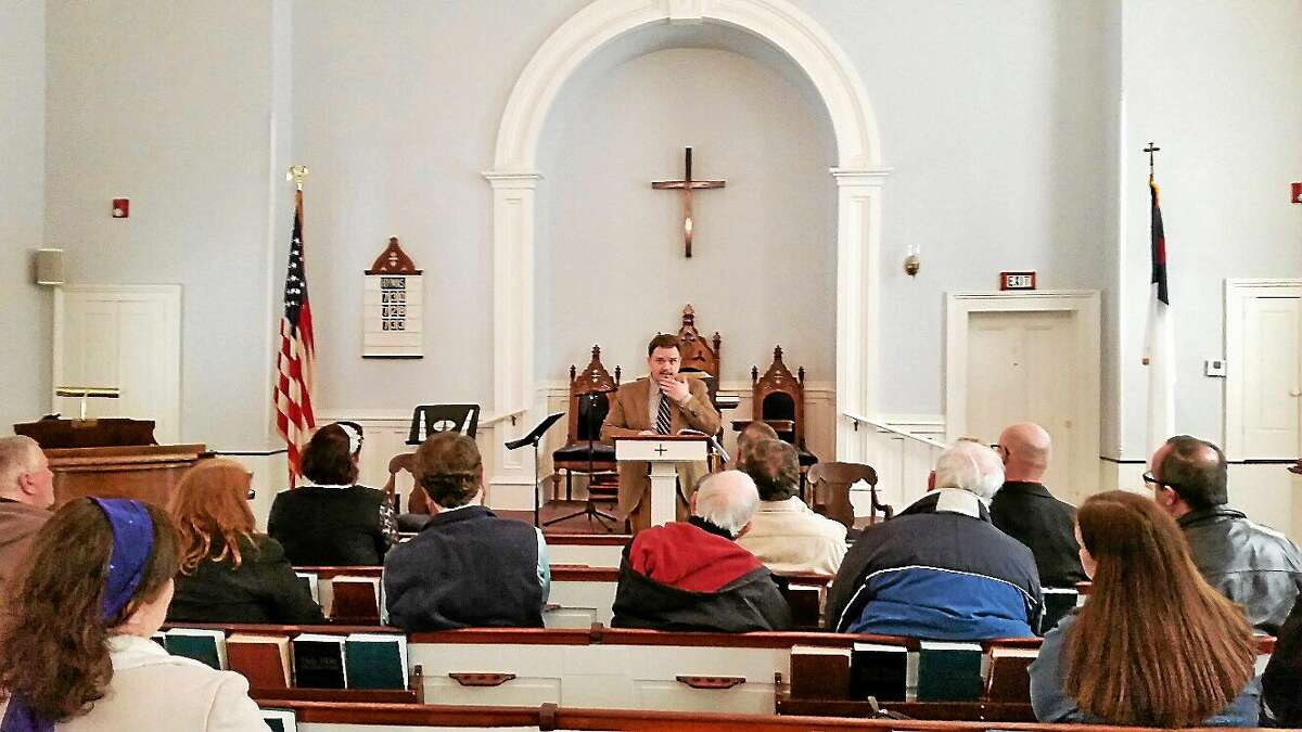 Actor and historian Luke G. Boyd discusses the mystery of The Colt Armory Fire of 1864 with a group of 30 people in attendance on Saturday afternoon at First Congregational Church at 865 Riverside Ave., Torrington. The talk is latest of many events sponsored by the Connecticut Civil War Round Table of Torrington.