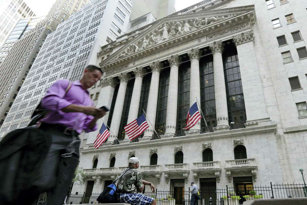 In this Friday, June 24, 2016, file photo, a man walks by the New York Stock Exchange. U.S. stock indexes were solidly higher in early trading Tuesday, June 28, 2016, as investors welcomed encouraging data on the economy and housing. The rebound followed even bigger gains in Europe as global markets recovered from a two-day rout triggered by Britain's vote to leave the European Union.