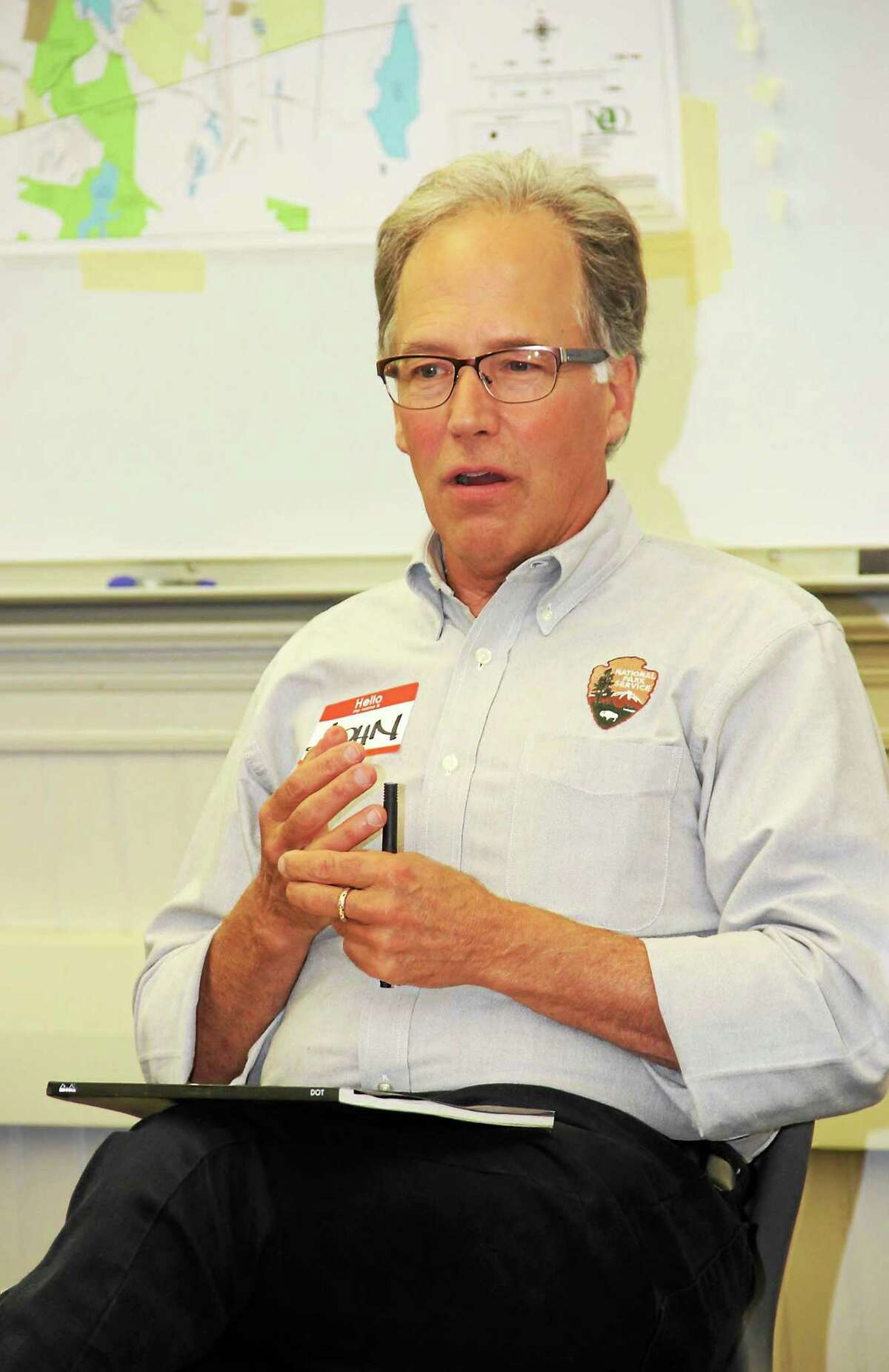 John Monroe, a National Parks Service professional who specializes in the organization's rivers and trails programs, offers assistance to Winsted Trails during a meeting Wednesday night at Northwestern Connecticut Community College.