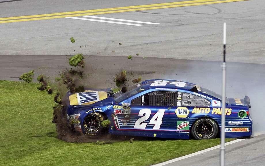 Chase Elliott (24) crashes during the NASCAR Daytona 500 auto race at Daytona International Speedway on Feb. 21, 2016, in Daytona Beach, Fla. Photo: AP Photo/Wilfredo Lee  / AP