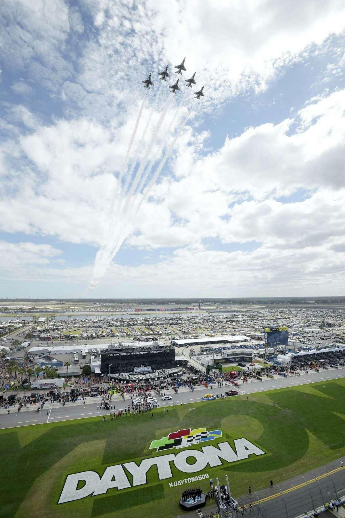 The U.S. Air Force Thunderbirds perform a flyover before the NASCAR Daytona 500 Sprint Cup series auto race at Daytona International Speedway on Feb. 21, 2016, in Daytona Beach, Fla.