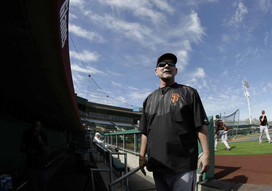 San Francisco Giants manager Bruce Bochy talks with fans as he leaves the field following Thursday's practice in Scottsdale, Ariz. Photo: Darron Cummings — The Associated Press  / AP