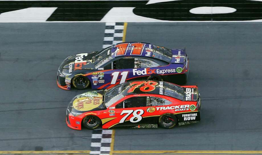 Denny Hamlin (11) beats out Martin Truex Jr. (78) at the finish line to win the NASCAR Daytona 500 auto race at Daytona International Speedway, Sunday, Feb. 21, 2016, in Daytona Beach, Fla. (AP Photo/Wilfredo Lee) Photo: AP / AP
