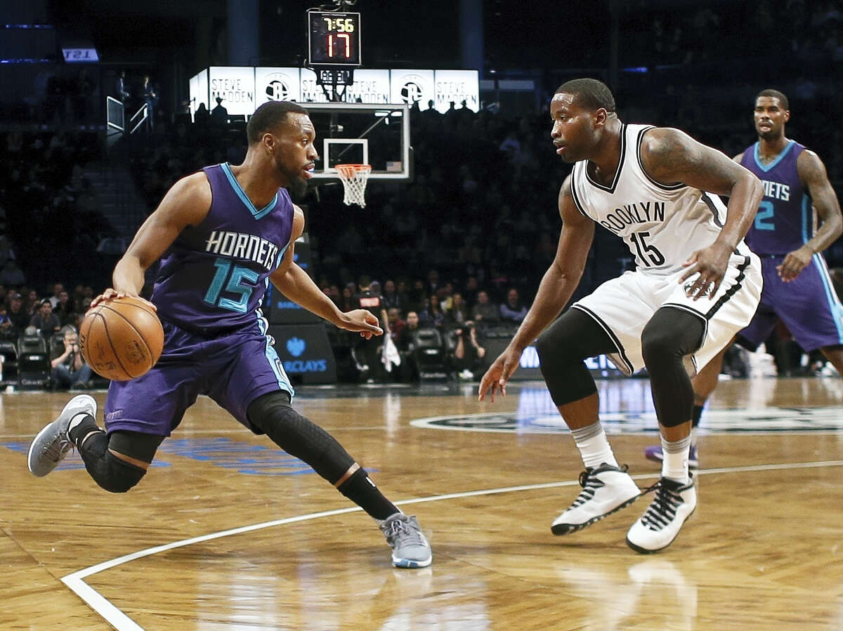 Brooklyn Nets' Donald Sloan (15) defends against Charlotte Hornets' Kemba Walker (15) during the first half of an NBA basketball game Sunday, Feb. 21, 2016, in New York. (AP Photo/Frank Franklin II)