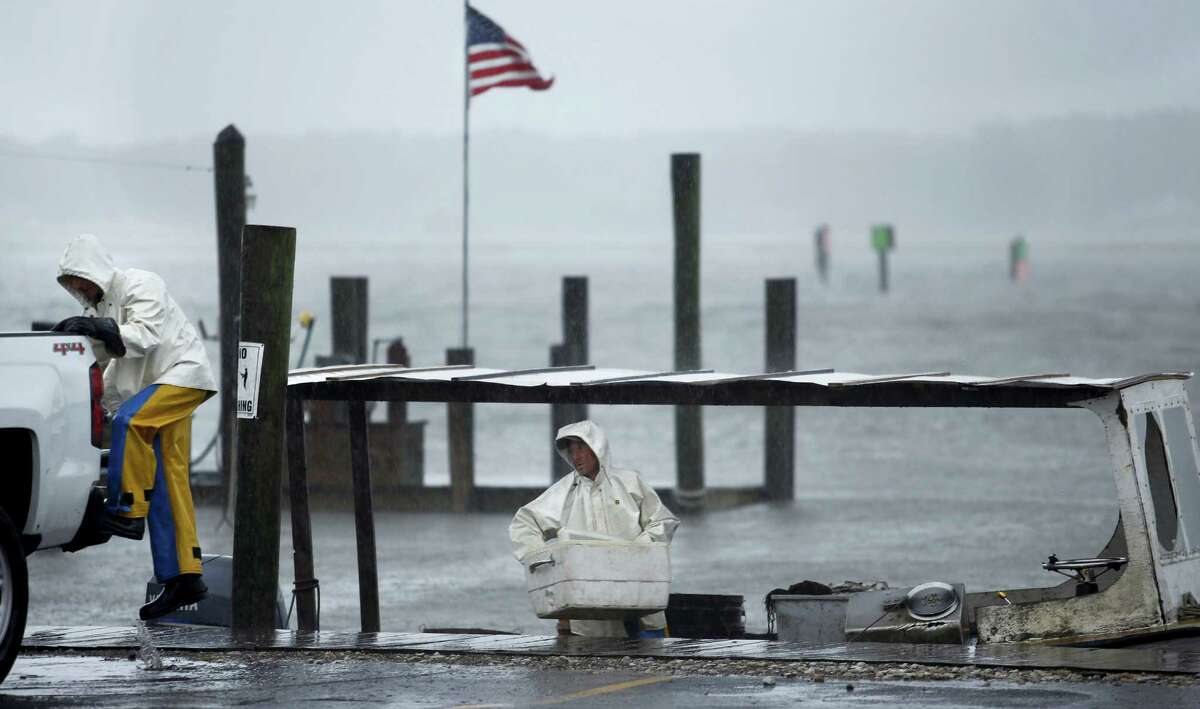Charlie Gregory, center, a local crabber, and his son Zach check their boat as Tropical Storm Hermine approaches Virginia Beach, Va., Saturday, Sept. 3, 2016. The National Hurricane Center says Tropical Storm Hermine could bring 4 to 7 inches of rain to southeastern Virginia and the Atlantic coastal portion of Maryland as well as 1 to 4 inches of rain over southern Delaware, southern and eastern New Jersey and Long Island through Monday morning.
