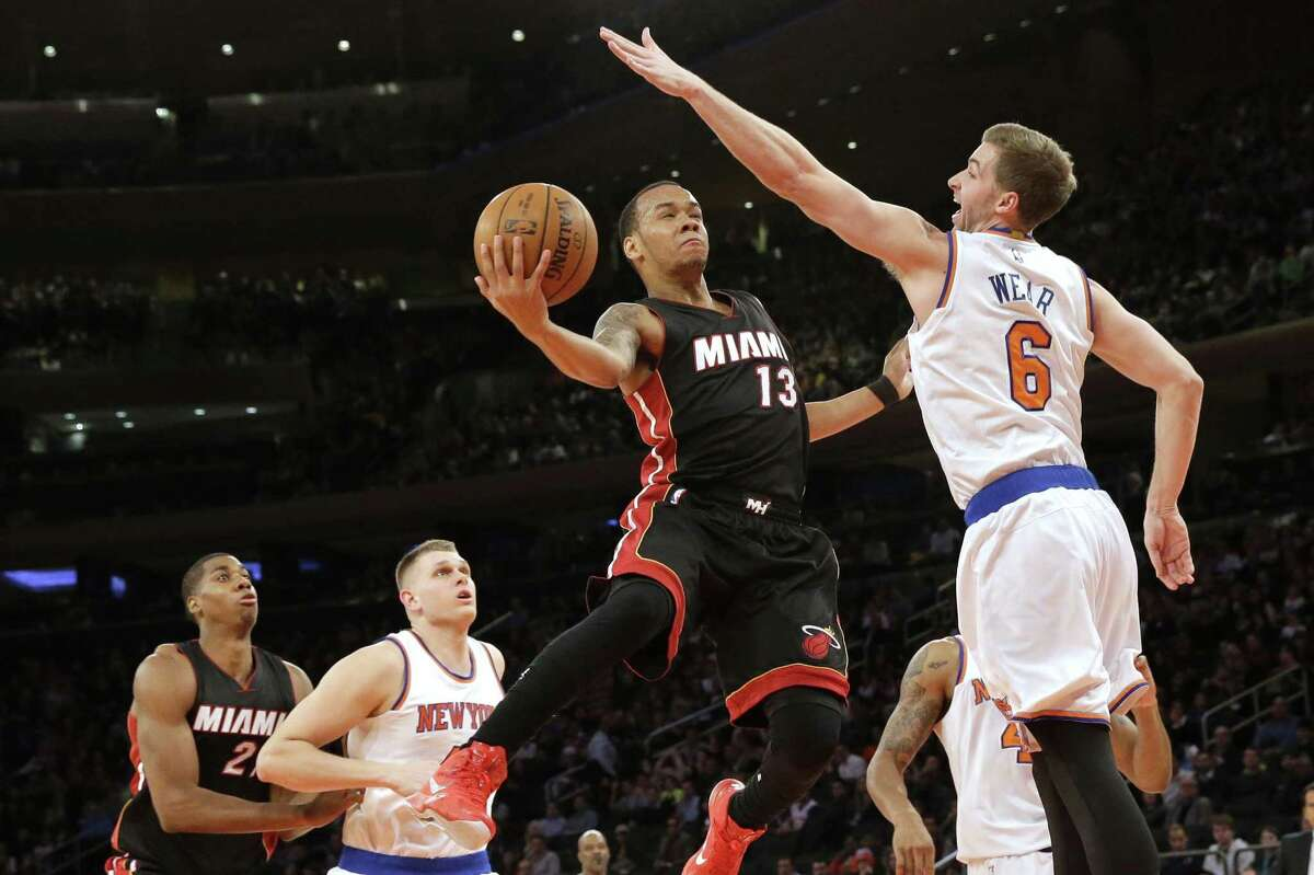 Miami Heat guard Shabazz Napier goes up against Knicks forward Travis Wear during the first half of Friday's game at Madison Square Garden in New York.