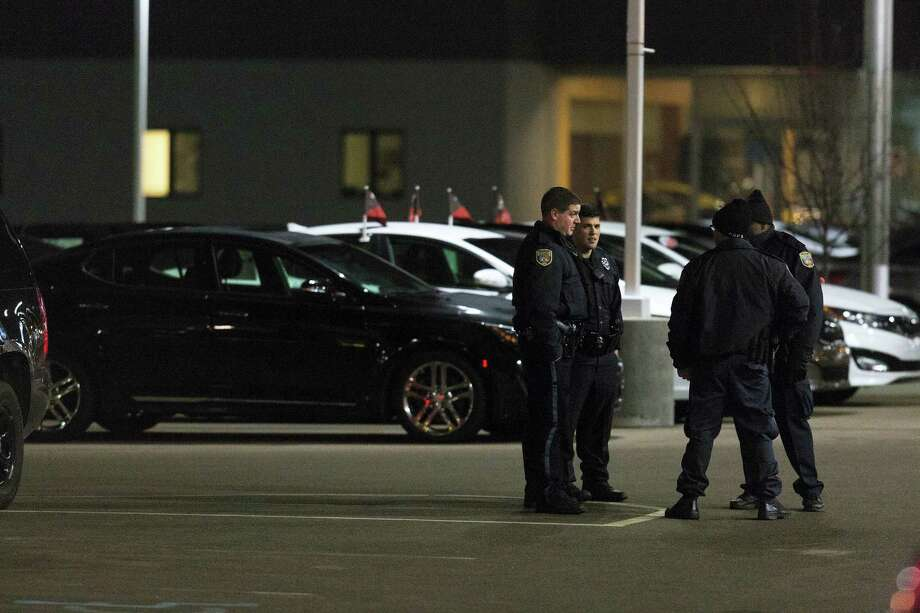 Police the area in the parking lot of a car dealership, after a random shooting on Feb. 21, 2016 in Kalamazoo. Photo: Bryan Bennett/Kalamazoo Gazette-MLive Media Group Via AP  / Kalamazoo Gazette-MLive Media Group