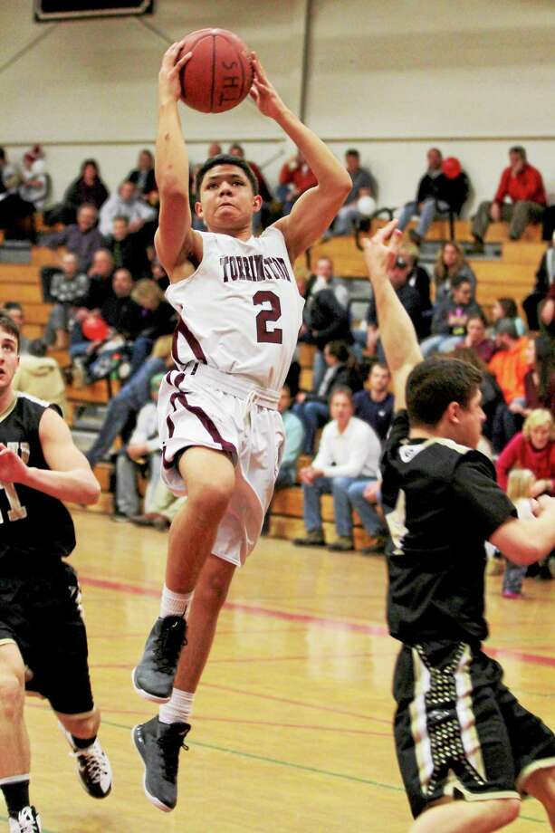 Torrington's Stephon Dailey goes up for a layup against Woodland Friday. Photo: Marianne Killackey — Special To Register Citizen  / 2014