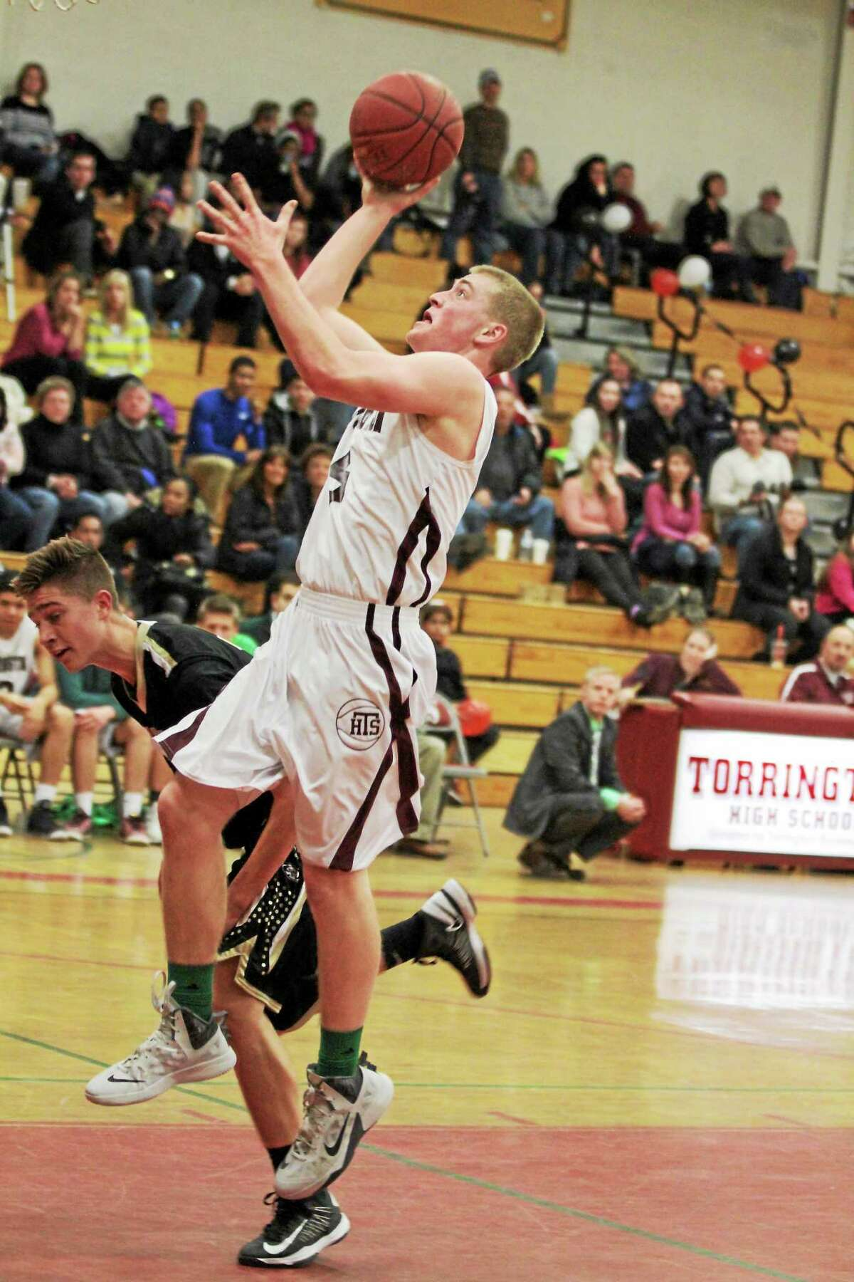 Torrington's Connor Finn goes up for a layup in his team's victory over Woodland.