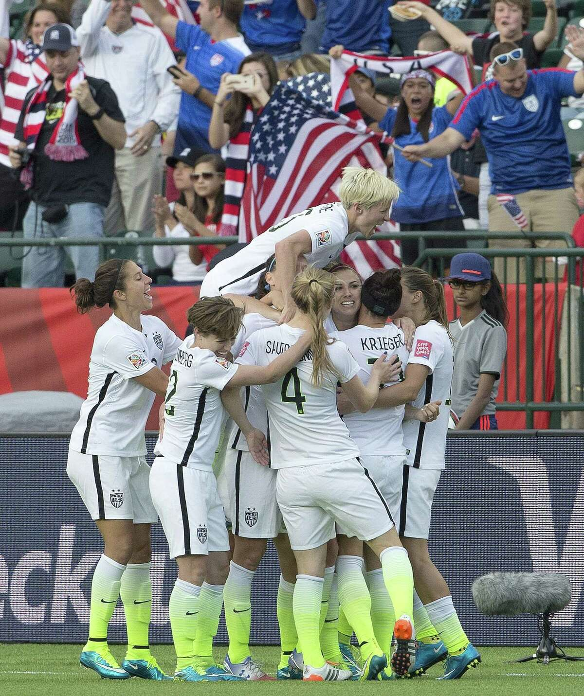 Members of the United States women's soccer team celebrate a goal against Colombia during second half on Monday.
