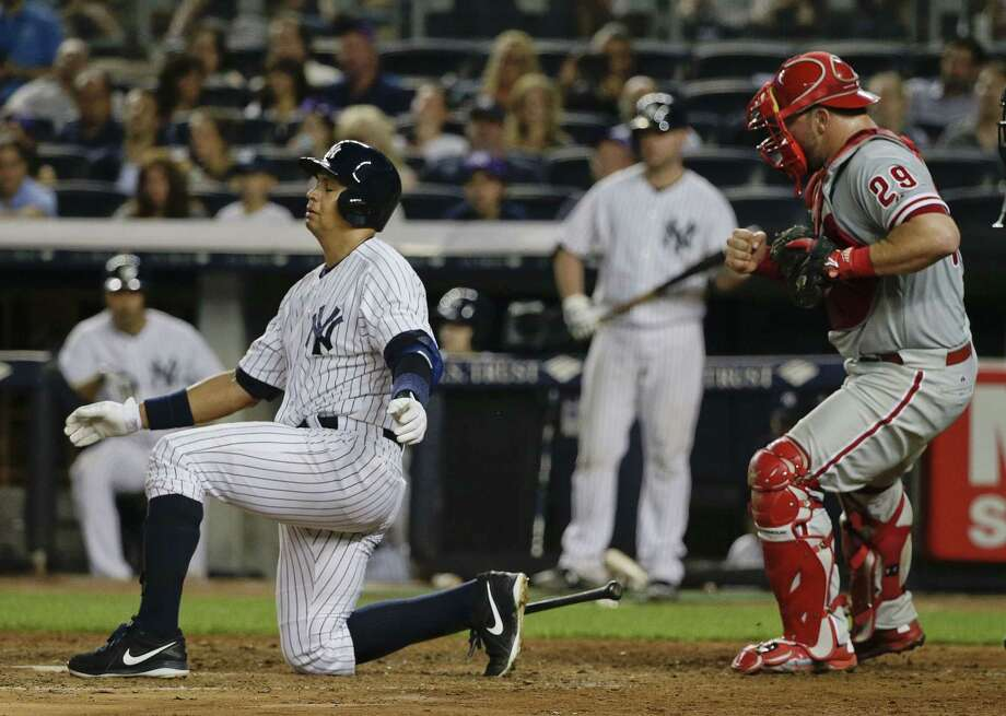 Yankees designated hitter Alex Rodriguez drops to a knee as he releases his bat after striking out in the sixth inning on Monday. Photo: Julie Jacobson — The Associated Press  / AP