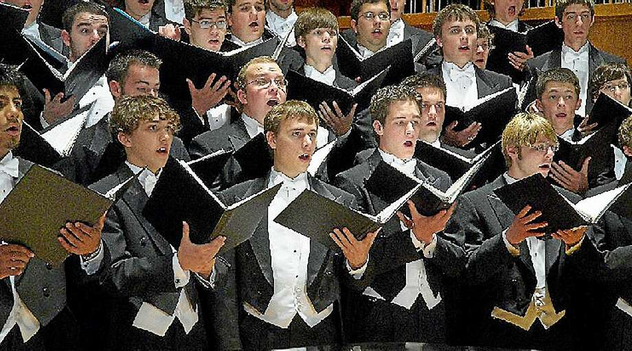 KENT SINGERS TO HOST PENN STATE GLEE CLUB   The Kent Singers will perform alongside the Penn State Menís Glee Club on Wednesday, March 11 at 7 pm at St. Johnís Episcopal Church in New Milford.  Admission is free.   Now in its 126th year, the Penn State Glee Club has gained a reputation as one of the elite menís choirs in the nation. Currently on an extensive tour of the East Coast under the direction of two-time Grammy winner Christopher Kiver, the Glee Club will perform a range of music, from the Renaissance to contemporary and Penn State songs.  The evening will begin with a short program by the Kent Singers featuring a cappella works of Byrd, Britten, and Purcell.   The Kent Singers, a small auditioned group of amateur singers from Litchfield County and the Pawling, NY area, has been performing since 1973.  Information is available at 860-619-8110 or www.kentsingers.org.  St. Johnís Church is at 7 Whittlesey Avenue, New Milford. Photo: Journal Register Co.