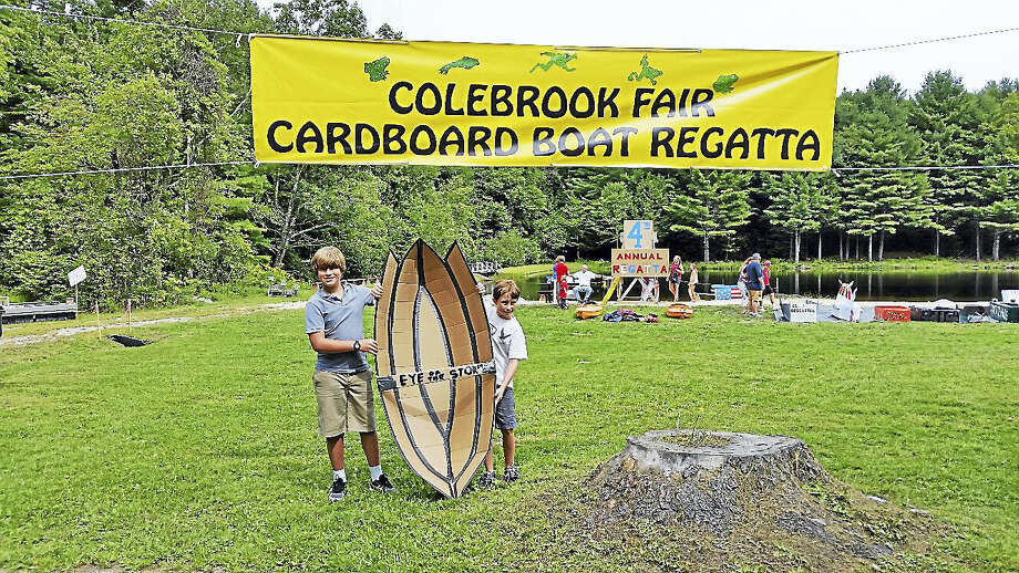 "Alec Vagliano, 11, and Nicolas Nino, 10, prepared to enter Vagliano's  cardboard boat ""Eye of the Storm"" into the Cardboard Boat Regatta at the 72nd annual Colebrook Fair at the intersection of Routes 183 and 182A on Saturday afternoon. The event, attended by about 1,000 visitors, featured 40 food and craft vendors; a magic act; a frog-jumping contest; live music; and firefighting drills for families. Photo: N.F. Ambery — The Register Citizen"