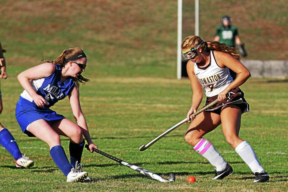 Julia Romaniello of Thomaston and Amanda Sullivan of Lewis Mills battle for control of the ball. Photo: MARIANNE KILLACKEY — REGISTER CITIZEN  / 2015