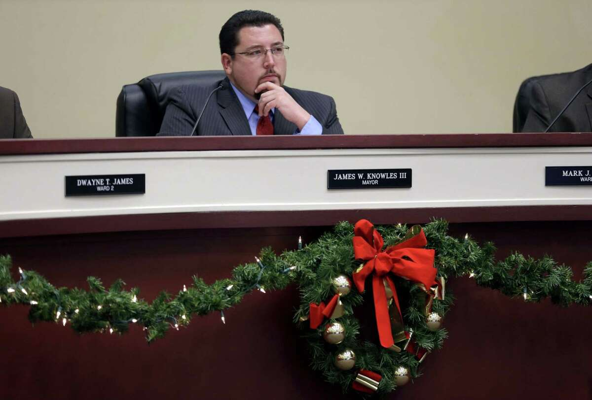 FILE - In this Dec. 9, 2014, file photo, Ferguson mayor James Knowles III listens during a meeting of the Ferguson City Council in Ferguson, Mo. Ferguson city leaders said Thursday, Feb. 19, 2015, they havenít heard from the U.S. Department of Justice regarding two federal investigations, one into the fatal shooting death of Michael Brown in August and the other into the city police departmentís practices. Ferguson City Attorney Stephanie Karr and Knowles said they have not been contacted by the Department of Justice about any findings, nor given a timeline for completion of the investigations, which began soon after Ferguson officer Darren Wilson fatally shot the black 18-year-old on Aug. 9. (AP Photo/Jeff Roberson, File)