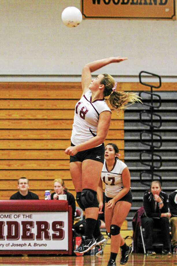 Torrington's Caitlyn Cornish hammers a shot against Granby on Monday night. Photo: MARIANNE KILLACKEY — REGISTER CITIZEN  / 2015