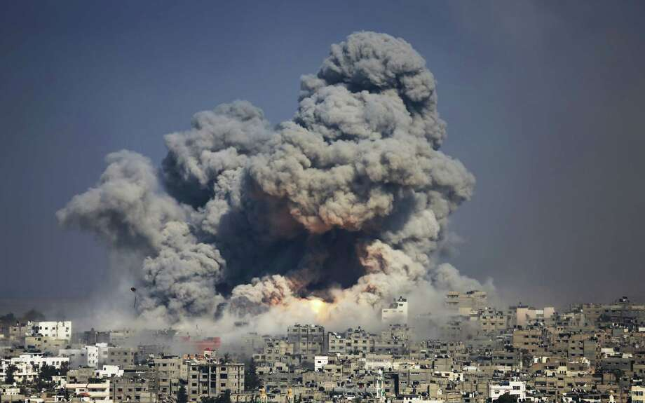 In this July 29, 2014 photo, smoke and fire from an Israeli strike rise over Gaza City. Photo: AP Photo/Hatem Moussa, File  / AP