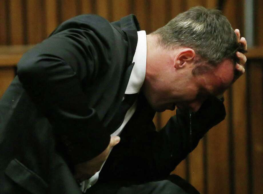 In this April 7, 2014 photo, Oscar Pistorius weeps as he listens to evidence by a pathologist in court in Pretoria, South Africa. Pistorius' release from prison to serve the remainder of a five-year manslaughter sentence under house arrest was the latest chapter in the story of a once-inspiring double-amputee runner who made history at the Olympics, and then killed his girlfriend, Reeva Steenkamp. Photo: AP Photo/Themba Hadebe, Pool-File  / AP POOL