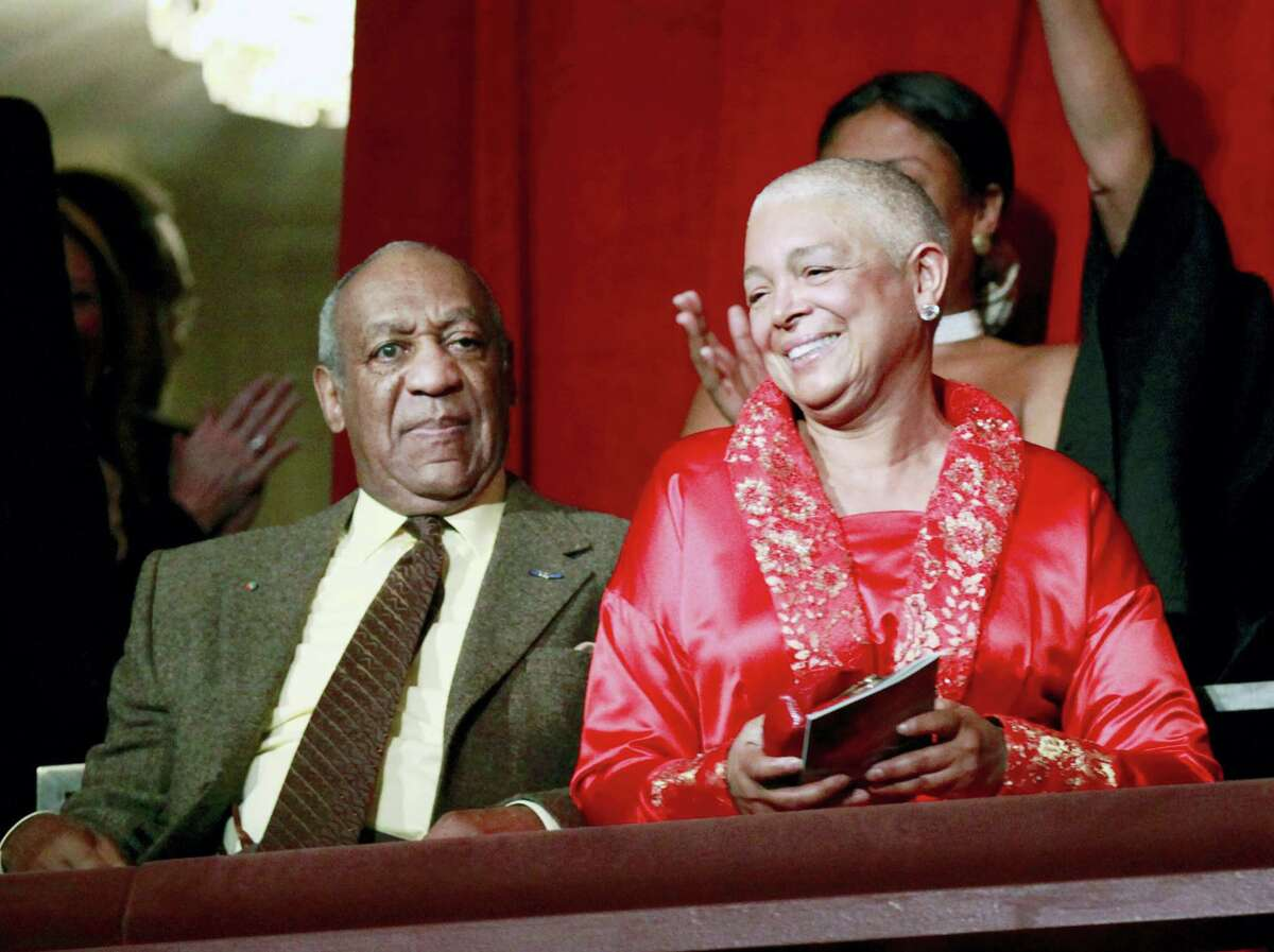 This Oct. 26, 2009 photo, comedian Bill Cosby, left, and his wife Camille appear at the John F. Kennedy Center for Performing Arts before Bill Cosby received the Mark Twain Prize for American Humor in Washington.