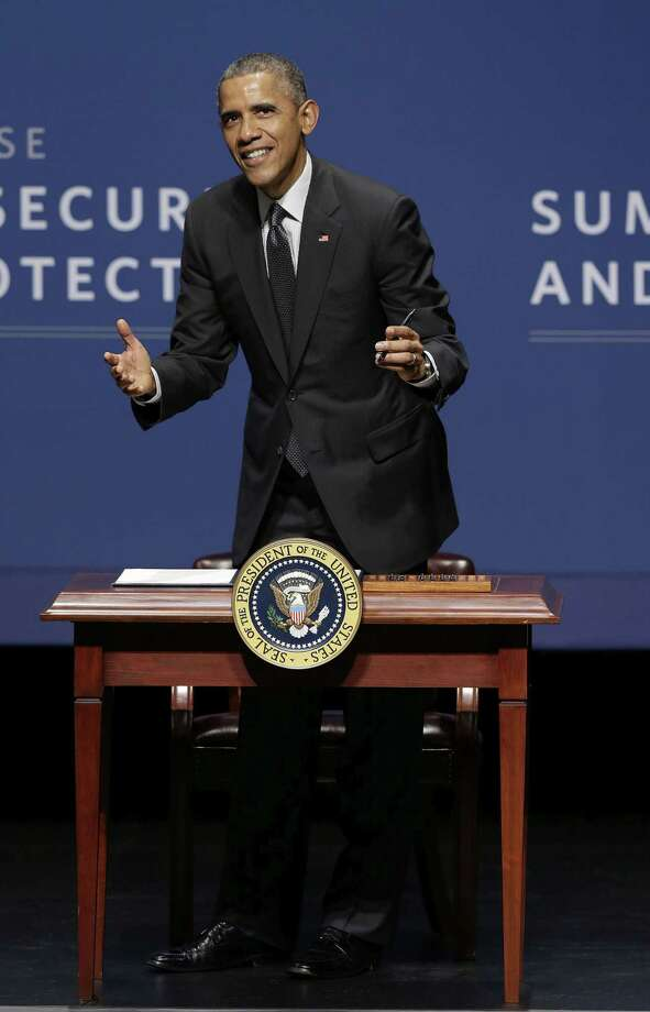 President Barack Obama smiles while signing an executive order after speaking at the White House Summit on Cybersecurity and Consumer Protection in Stanford, Calif., Friday, Feb. 13, 2015. (AP Photo/Jeff Chiu) Photo: AP / AP