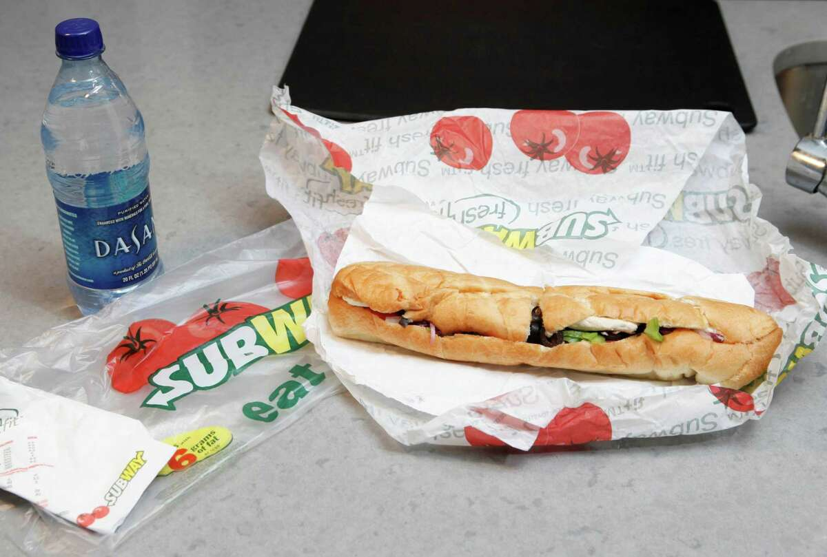 This file photo, shows a chicken breast sandwich and water from Subway on a kitchen counter in New York.