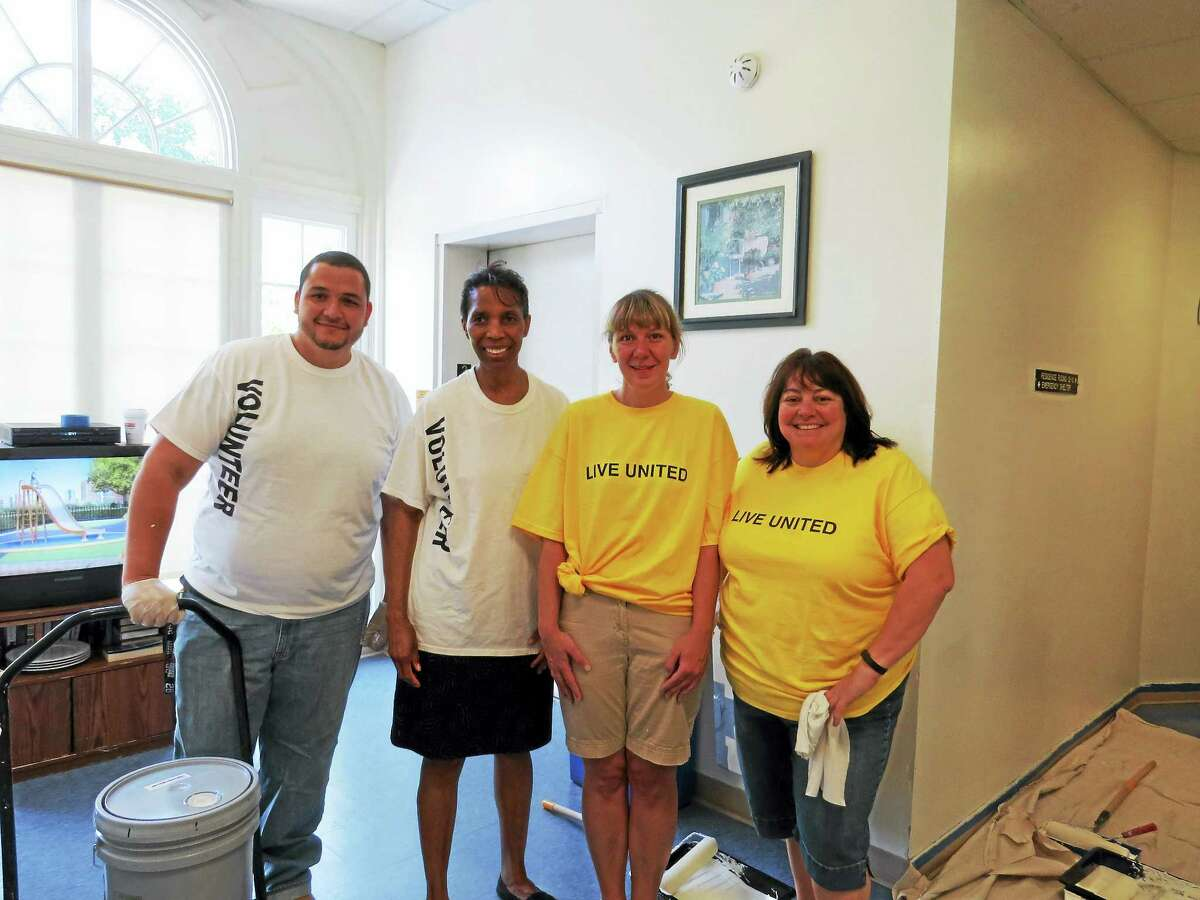 Contributed photoFrom left, Union Savings Bank employees volunteering at the Northwest CT YMCA's Winsted Branch during the United Way's recent Day of Caring included Rosana Vidal, Joy Robertson, Robin Hollister, and Andrew Jimenez.