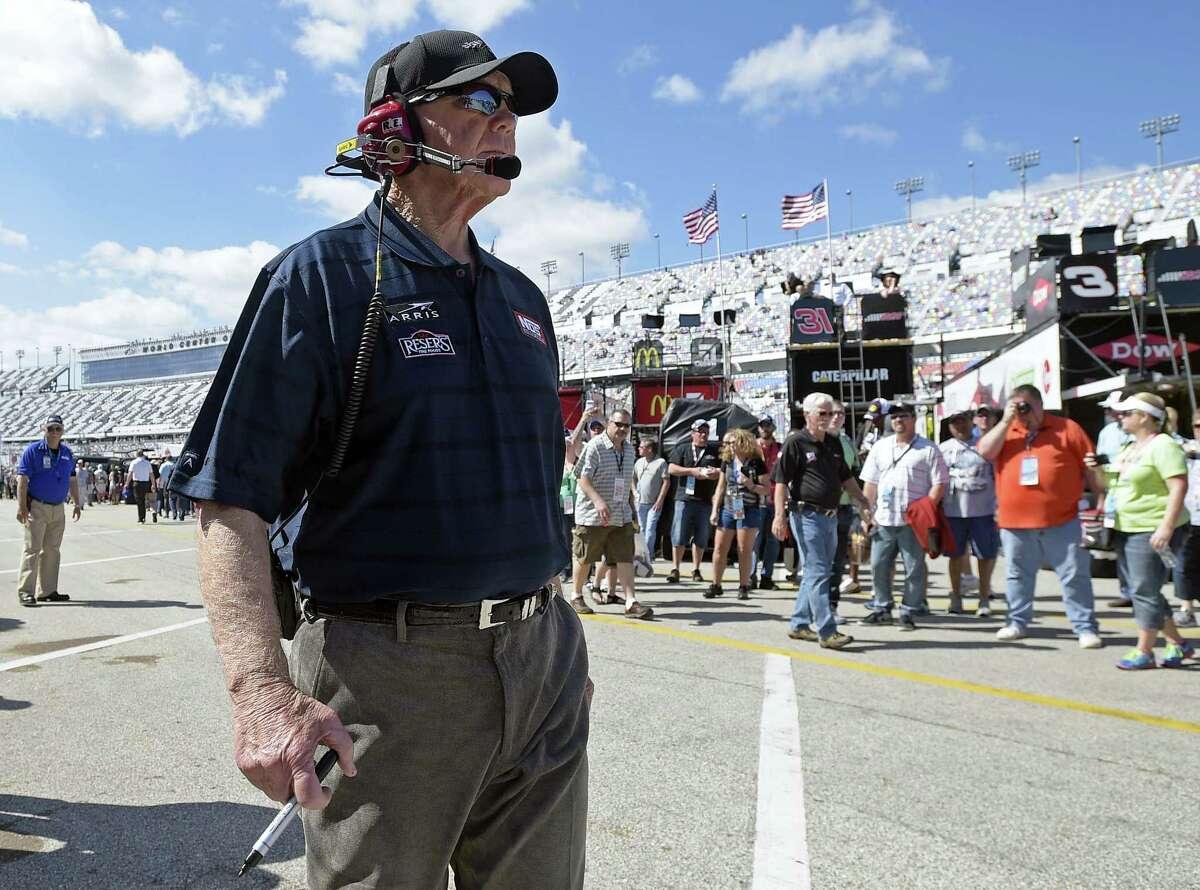Team owner Joe Gibbs walks through the garage area during practice for today's Daytona 500.