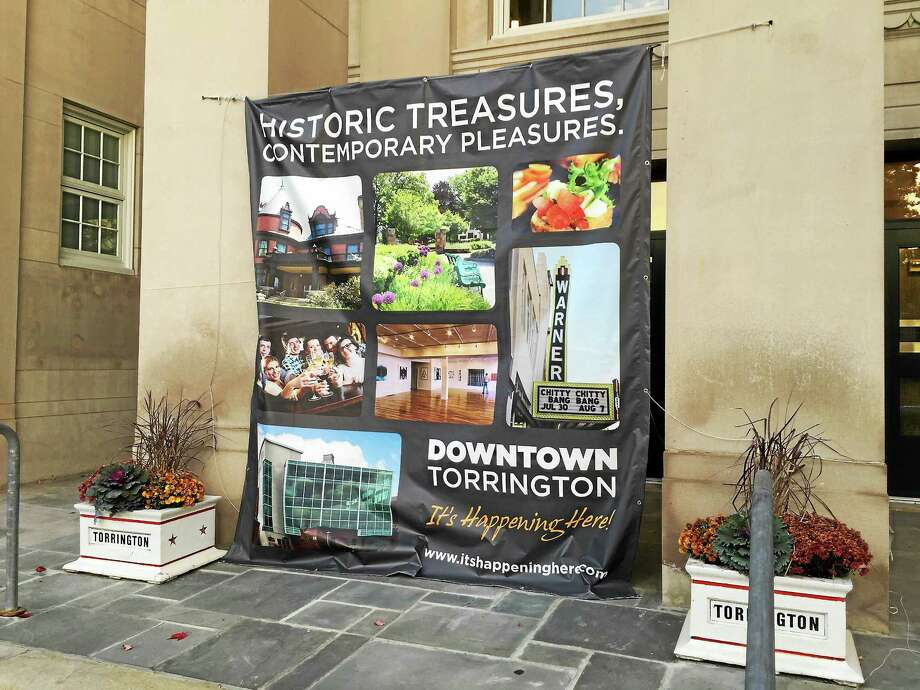 BEN LAMBERT — THE REGISTER CITIZEN New branding imagery hangs outside City Hall in Torrington. The branding was recently unveiled at the celebration of the city's 275th anniversary and shared with the City Council Monday evening. Photo: Journal Register Co.