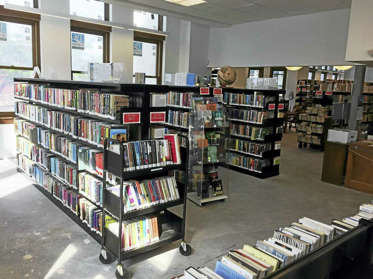 Ben Lambert - The Register CitizenThe Torrington public library re-opened to patrons earlier this week.