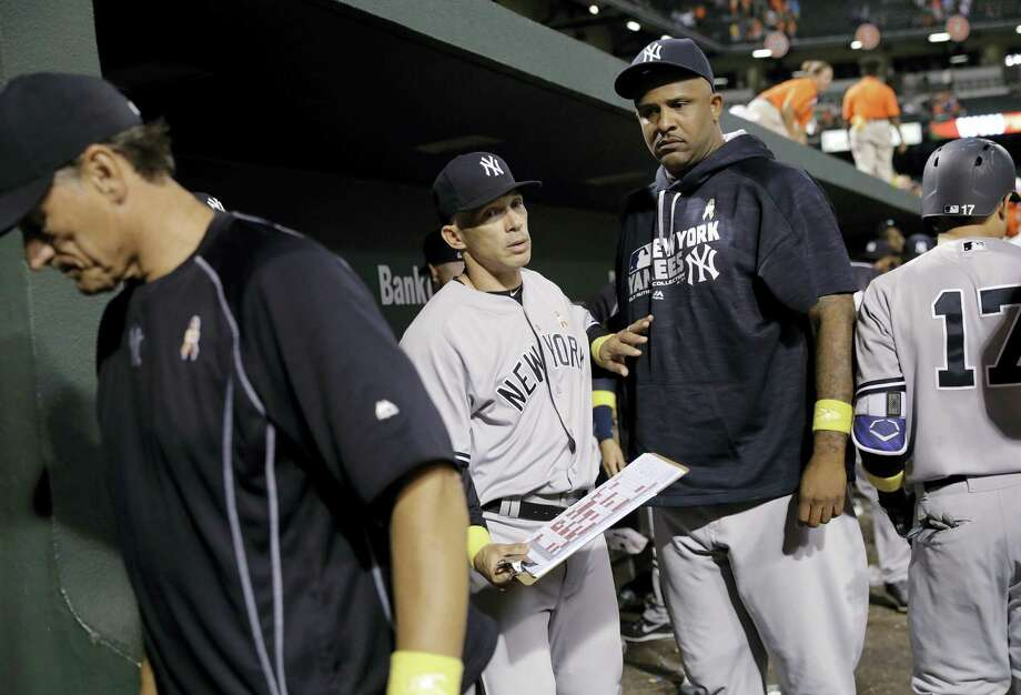Yankees manager Joe Girardi, second from left, and pitcher CC Sabathia walk out of the dugout after Friday's loss. Photo: Patrick Semansky — The Associated Press  / Copyright 2016 The Associated Press. All rights reserved.