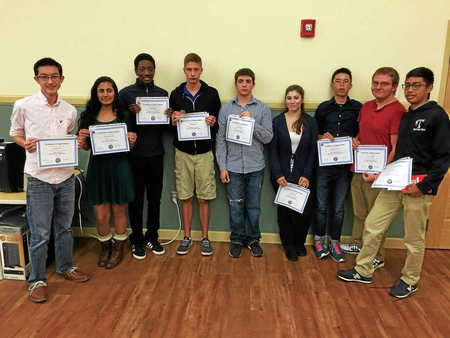BEN LAMBERT — THE REGISTER CITIZEN These Torrington High School students were honored Monday evening, as their recent summer internship with the city government was commemorated. Photo: Journal Register Co.