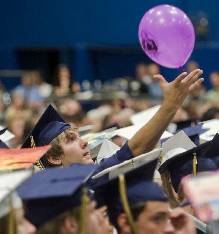 Tyler Lathrope tries to keep a circulating balloon in play during the Brookfield High School graduation ceremony at the O'Neil Center. Saturday, June 19, 2010 Photo: Scott Mullin / The News-Times Freelance