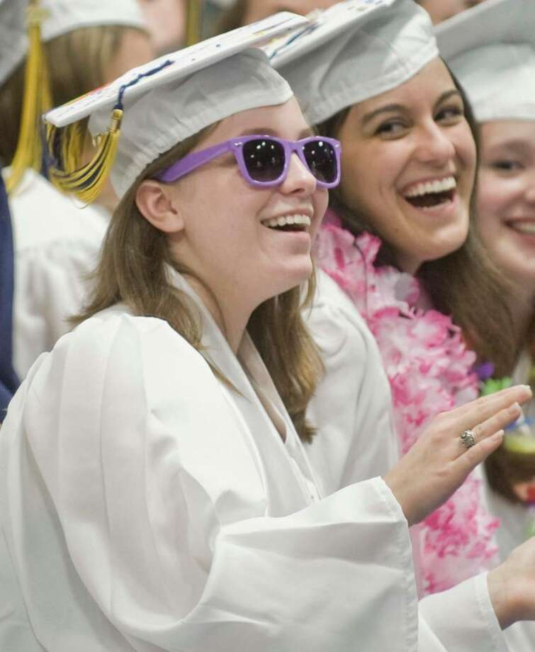Anne Smith and Deanna Gialanella singing during the Brookfield High School graduation ceremony at the O'Neil Center. Saturday, June 19, 2010 Photo: Scott Mullin / The News-Times Freelance