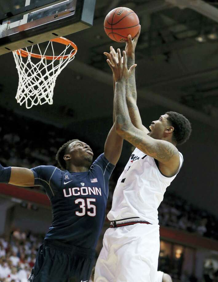 Cincinnati's Octavius Ellis, right, shoots against UConn's Amida Brimah during the first half on Saturday. Photo: Gary Landers — The Associated Press  / FR171284 AP
