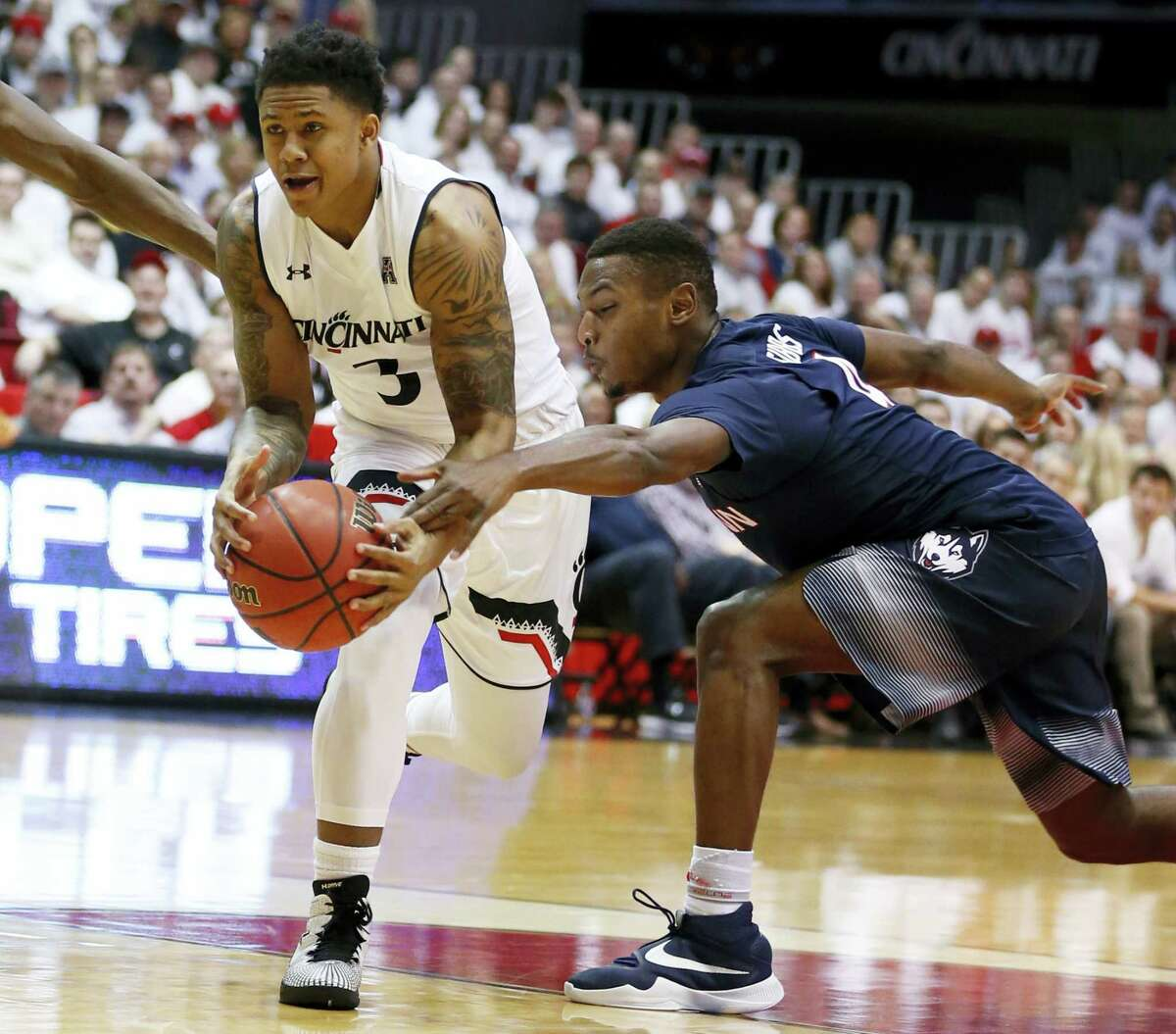 UConn's Sterling Gibbs, right, attempts a steal on Saturday.