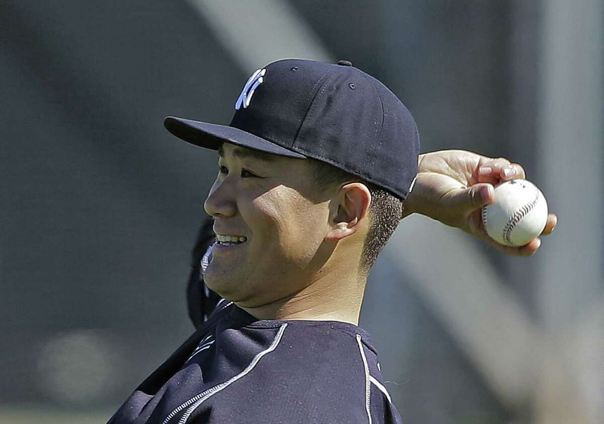 New York Yankees starter Masahiro Tanaka loosens up his arm before throwing a bullpen session Thursday at the team's minor league complex in Tampa, Fla.