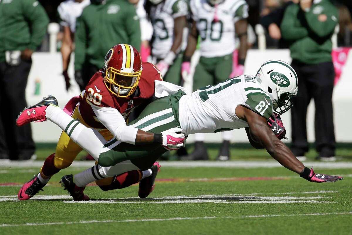 New York Jets wide receiver Quincy Enunwa (81) is tackled by Washington Redskins strong safety Kyshoen Jarrett (30) during the first half of an NFL football game, Sunday, Oct. 18, 2015, in East Rutherford, N.J. (AP Photo/Seth Wenig)