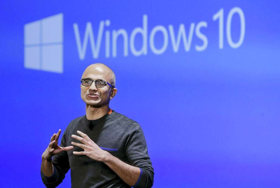 In this Jan. 21, 2015 photo, Microsoft CEO Satya Nadella speaks at an event demonstrating the new features of Windows 10 at the company's headquarters in Redmond, Wash. As Windows 10 approaches its first birthday, Microsoft is adding new features to its flagship operating software. Photo: AP Photo/Elaine Thompson, File  / Copyright 2016 The Associated Press. All rights reserved. This material may not be published, broadcast, rewritten or redistribu