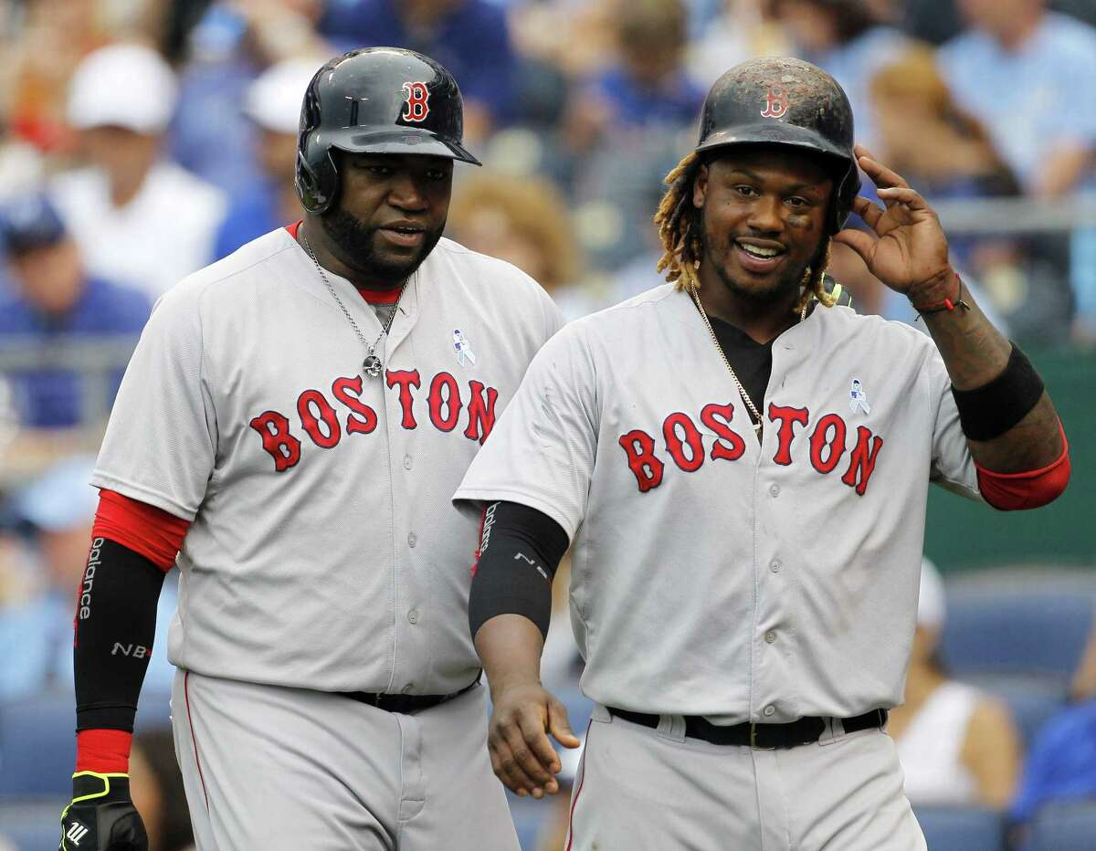 David Ortiz, left, and Hanley Ramirez, right, head to the dugout after scoring on a Xander Bogaerts double in the fifth inning on Sunday.
