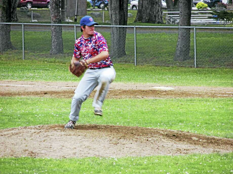 Winsted's Vinny Tranceti dueled with Simsbury starter Kevin Gurry before the battle began at Winsted's Walker Field Tuesday evening. Photo: Photo By Peter Wallace
