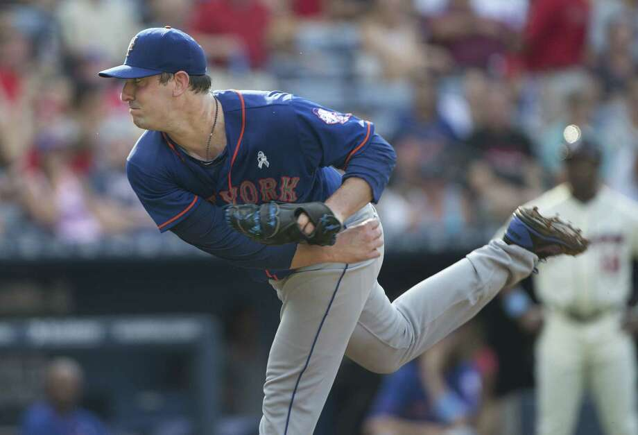 Mets starting pitcher Matt Harvey delivers a pitch against the Braves (33) works in a baseball game against the Atlanta Braves Sunday, June 21, 2015, in Atlanta.  (AP Photo/John Bazemore) Photo: John Bazemore — The Associated Press  / AP
