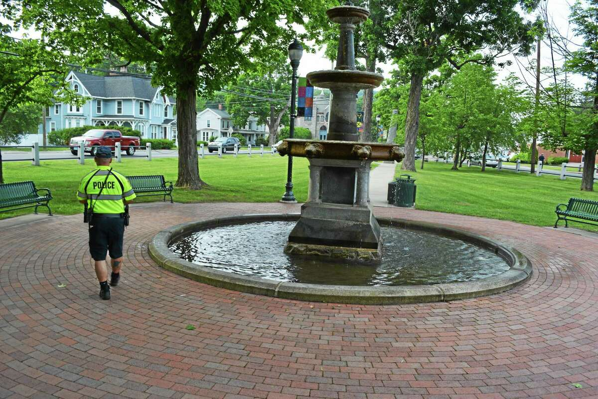 Winchester police officer Daniel Pietrafesa walks through downtown Winsted while conducting a foot patrol.