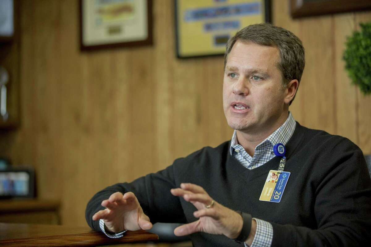 Wal-Mart President and Chief Executive Officer Doug McMillon speaks during an interview with The Associated Press on Feb. 17, 2015, in Bentonville, Ark. Wal-Mart Stores Inc. is spending $1 billion to change how it pays and trains hourly staff in a move it hopes will help reshape the image that it only offers dead-end jobs.
