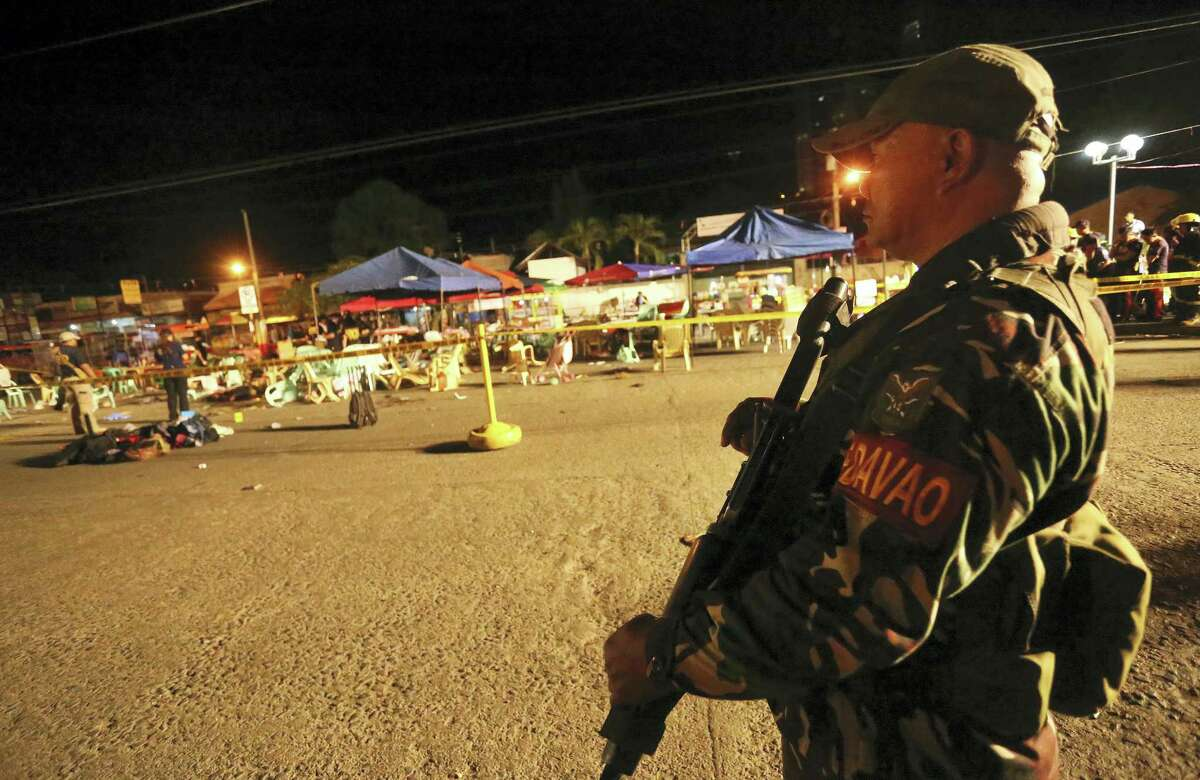 A Philippine soldier keeps watch at a blast site at a night market that has left several people dead and wounded others in southern Davao city, Philippines late Friday Sept. 2, 2016. The powerful explosion in Philippine President Rodrigo Duterte's hometown in the southern Philippines took place amid a security alert due to a major offensive against Abu Sayyaf militants in the region, officials said.