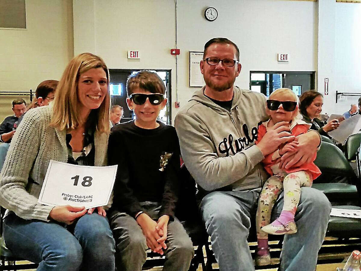 From left to right: Sarah Prout; her son Ethan, 10; her husband Joe Prout; and her daughter Emily, 18 months old, all of Torrington, attended the 46th Annual PROBUS Club/LARC Auction at Coe Memorial Park Civic Center in Torrington on Sunday.