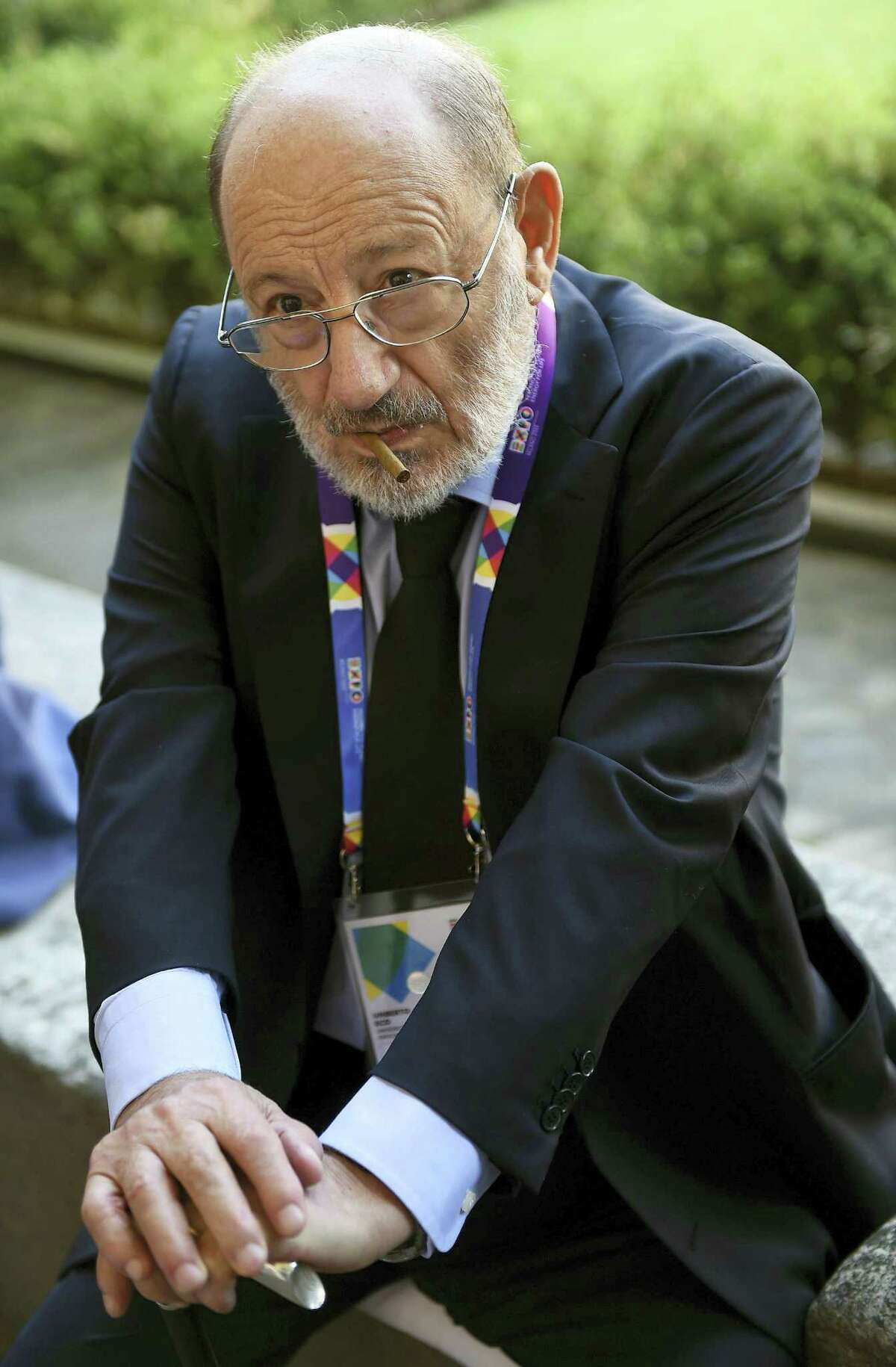"""In this Aug. 1, 2015 file photo, Italian writer Umberto Eco waits to visit Italian artist Leonardo Da Vinci's painting """"The last Supper"""", Milan, Italy. Eco, best known for the international best-seller """"The Name of the Rose,"""" died Friday, Feb. 19, 2016. He was 84."""