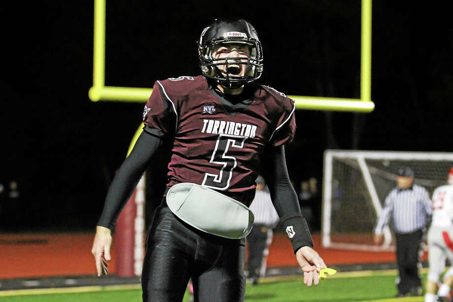 Torrington Quarterback Connor Finn celebrates after one of his team's touchdowns Friday against Wolcott. Photo: Photos By Marianne Killackey -- Register Citizen  / 2015