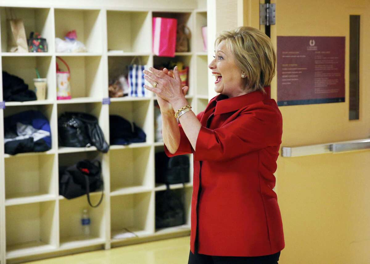 Democratic presidential candidate Hillary Clinton reacts as she visits with Harrah's Las Vegas employees on the day of the Nevada Democratic caucus, Saturday, Feb. 20, 2016, in Las Vegas.