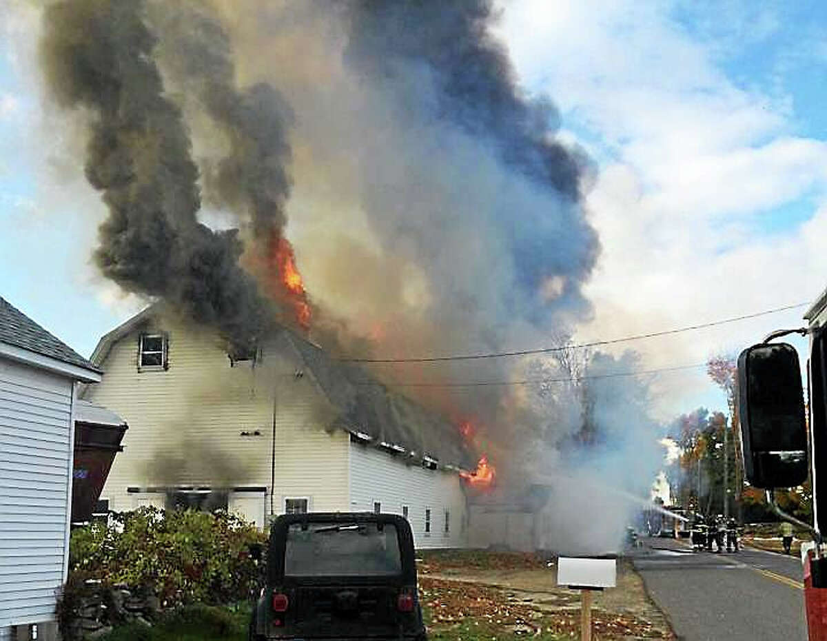 Firefighters from around the region worked for several hours Sunday evening to control a barn fire on Ridge Road. A large amount of hay inside the barn fueled the flames, which went shooting through the roof.